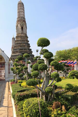derives: BANGKOK, THAILAND - December 15, 2014: Wat Arun (Temple of Dawn) Temple derives name from the Hindu god Aruna, personified as the radiations of the rising sun. Editorial