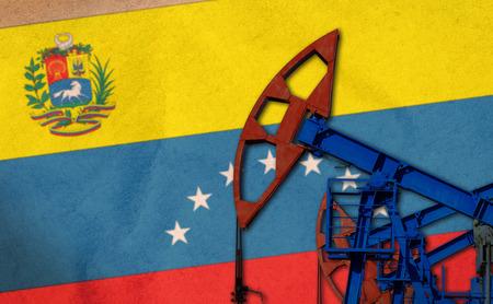 close-up van de oliepomp op de achtergrond van de vlag Venezuela
