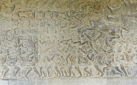 murals: close-up texture of stone carving ancient bas-reliefs of the Temple of Angkor Wat in Cambodia Stock Photo