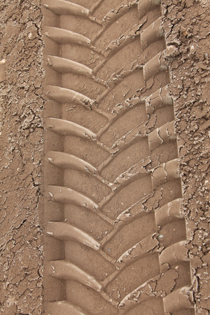 Close-up tire tracks truck on a dirt road in daylight