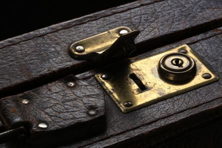 lock: close-up fragment of locks and fasteners on the vintage leather suitcase brown Stock Photo