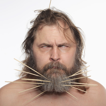 close-up portrait of a cheerful man with a sticks in beard studio Stock Photo