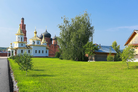 is cloudless: Summer landscape friary near the forest on a clear cloudless day