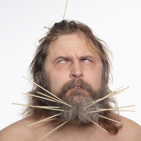 close-up portrait of a cheerful man with a sticks in beard studio Imagens