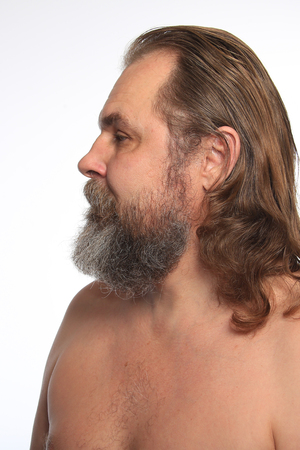 graying: close-up portrait of a charismatic man with a beard and mustache Studio Stock Photo