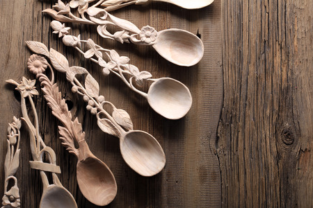 decomposed: macro wooden spoon with carved handles decomposed fan on wood background studio