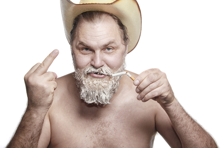 cowboy beard: Portrait of a old cowboy quit smoking at the time of dyeing his beard studio Stock Photo