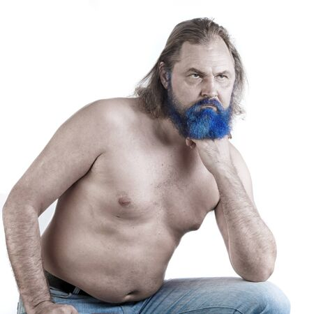 close-up portrait of an adult male with long hair, blue beard and torso on white background studio Stock Photo