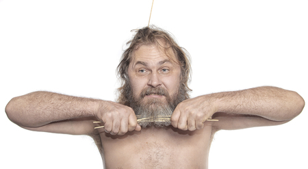graying: close-up portrait of a cheerful man with a sticks in beard studio Stock Photo