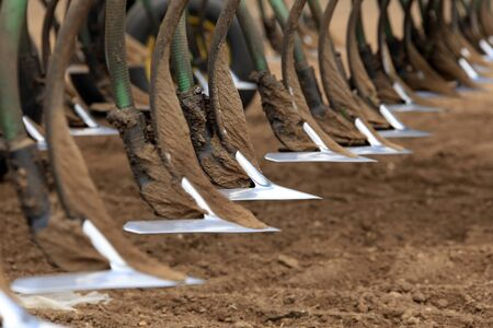 close-up Agricultural machinery, metal plow in the field during the spring planting season