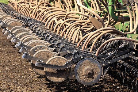 planting season: close-up Agricultural machinery, metal plow in the field during the spring planting season