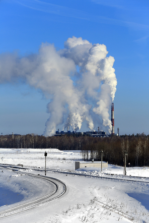 close up chimney: industrial landscape with the freight train tanks near a chemical plant clear winter day