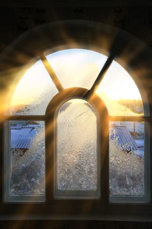 closeup texture background window in hoarfrost in sunlight rays Standard-Bild