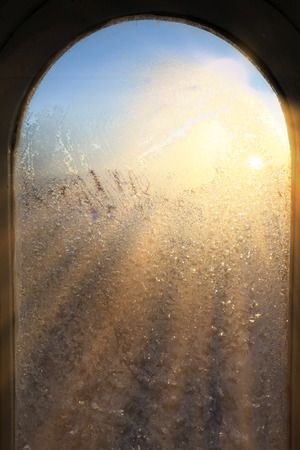 closeup texture background window in hoarfrost in sunlight rays Stock Photo