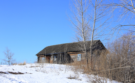 timbered farmhouse on the outskirts of a clear day in winter