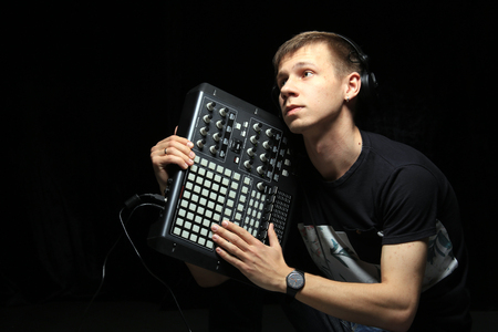 A young DJ party holds pad controllers in the studio Stockfoto - 97233694