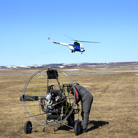 close-up of the motor glider on the ground in the early spring and the pilot is ready to fly Stockfoto