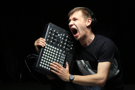 A young DJ party holds pad controllers in the studio Stockfoto - 97232346