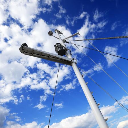 closeup White yacht mast against the blue sky