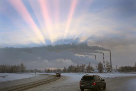 冬の景観・日差し CHP の煙突からの煙の雲から 写真素材