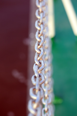 antique factory: macro old chain on a yacht in the sunshine Stock Photo