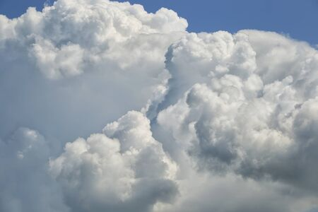 background beautiful fluffy white clouds on a blue sky on a sunny day Stock Photo