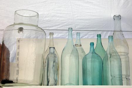 macro old glass bottles at flea market Stock Photo