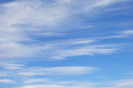 macro background texture weightless clouds on a blue sky on a sunny day Stock Photo