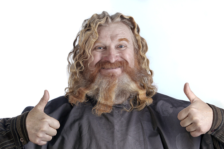 closeup portrait of an adult red-haired man with long wavy hair and beard on a white background Stock Photo