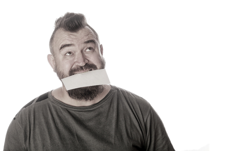 close-up portrait of a man with a sign in his mouth on a white studio background Stockfoto - 97226916