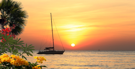 seascape scenic sunset and anchored boat with deflated sails off the coast of Thailand Banco de Imagens