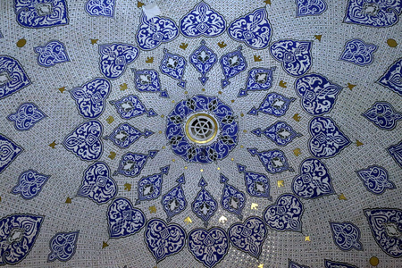 Detail of a mosaic of ceramic tiles in a madrassa