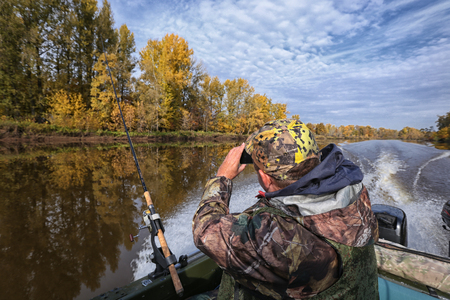 Autumn fishing from the motor boat to the wobblers Stockfoto