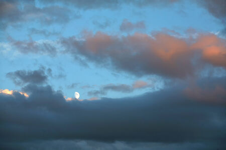 vortices: beautiful blue sky with clouds feather and moon