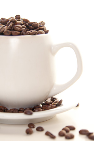 full cup of coffee, coffee beans for breakfast Фото со стока - 33645566