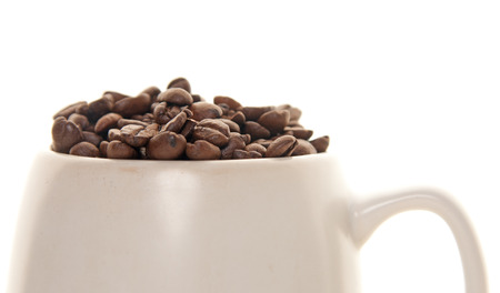full cup of coffee, coffee beans for breakfast Фото со стока