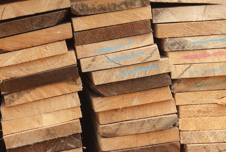 narrow depth of field: Stack of Building Lumber at Construction Site with Narrow Depth of Field.