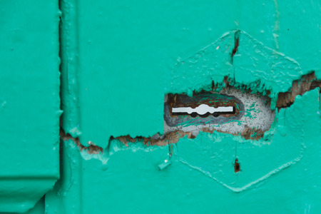 scraped: A scraped wooden door with keyhole.