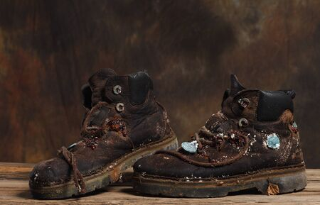 outsole: very old hiking boots with a new civilization