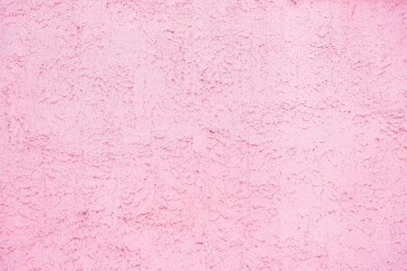 Pink background texture of decorative plaster on the wall