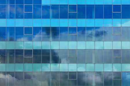 Cool-background texture of the windows of a glass building.