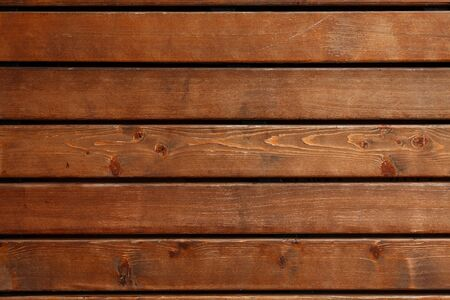 Bright wooden background texture. Brown plank flooring with crevices;