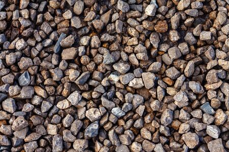 Fine crushed stone in warm light