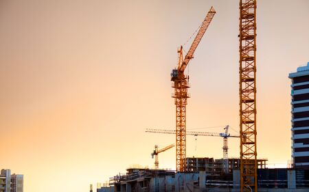 The process of building a residential complex. Construction view with several construction cranes