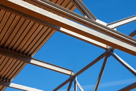 Steel architectural structure of iron beams and corrugated board against a blue sky Foto de archivo