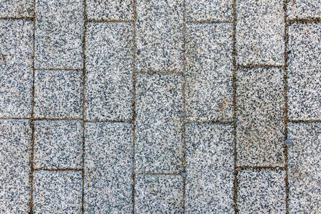 Masonry of gray as smooth as a brick of sidewalk stone