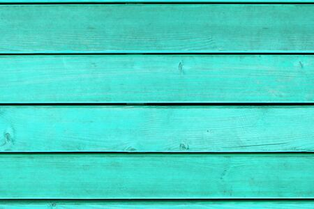Horizontal plank flooring in bright turquoise color Foto de archivo