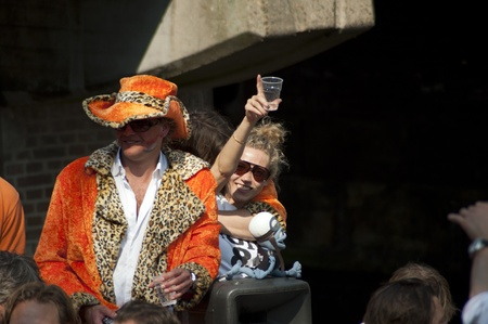 Amsterdam, Netherlands – April 30, 2011 - People celebrating Queen's Day Stock Photo - 13256782