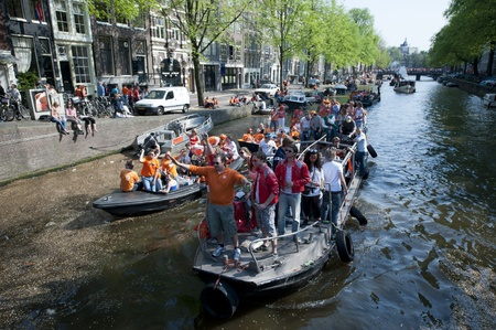 Amsterdam, Netherlands � April 30, 2011 - Crowd on Boat Celebrating Queensday