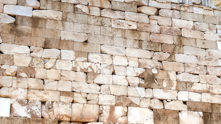 Brick wall of Athenian Treasury in Delphi, an archaeological site in Greece, at the Mount Parnassus.